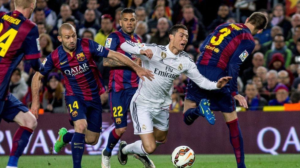 Mascherano tackles Ronaldo.