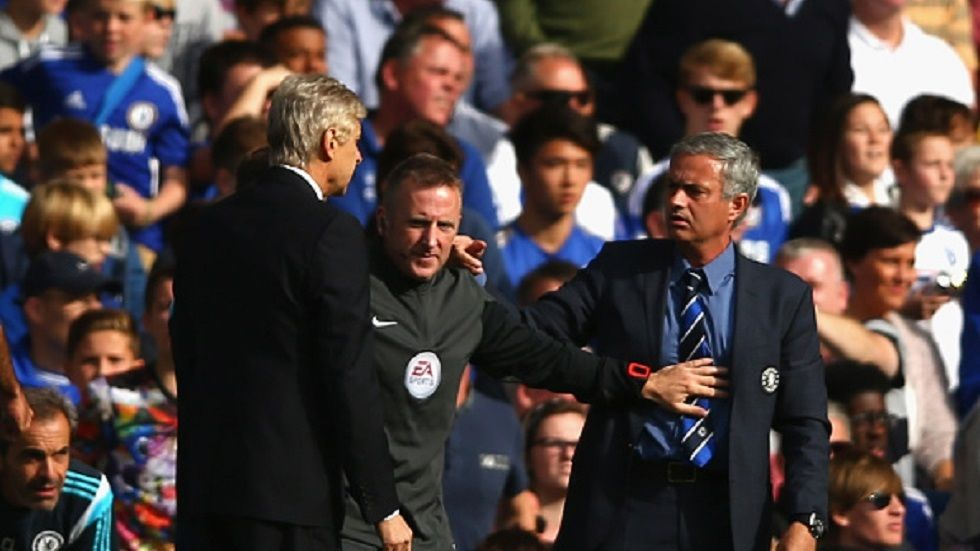 An official breaks off a fight between Jose Mourinho and Arsene Wenger during a past match between Arsenal and Chelsea