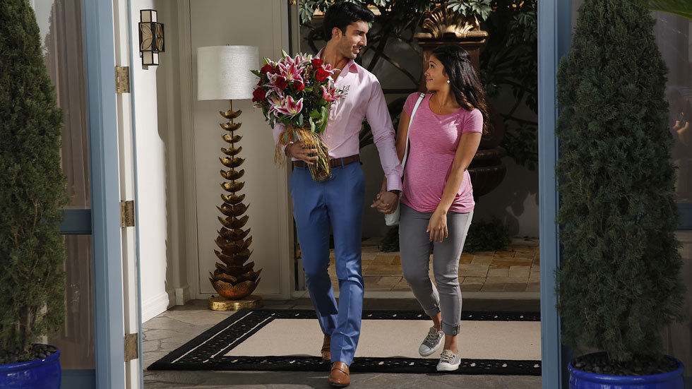 A photo of Jane played by Gina Rodriguez holding hands with Rafael played by Justin Baldoni on Jane The Virgin on Vuzu Amp