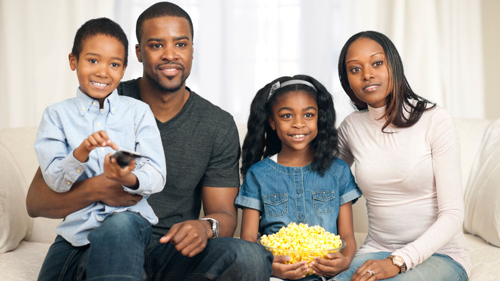 Stock image of a family to be used in the digital migration spotlight.