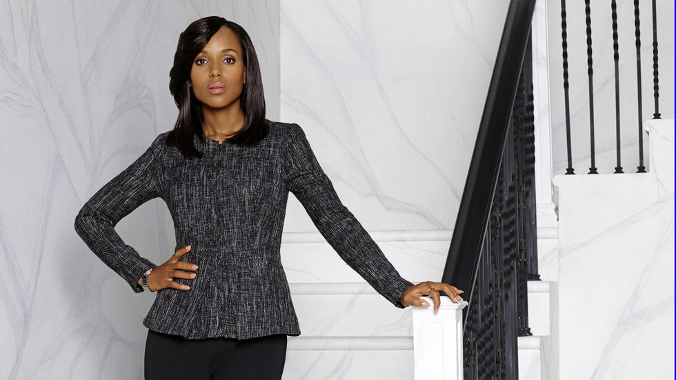 Kerry Washington as Olivia Pope poses on a flight of stairs.