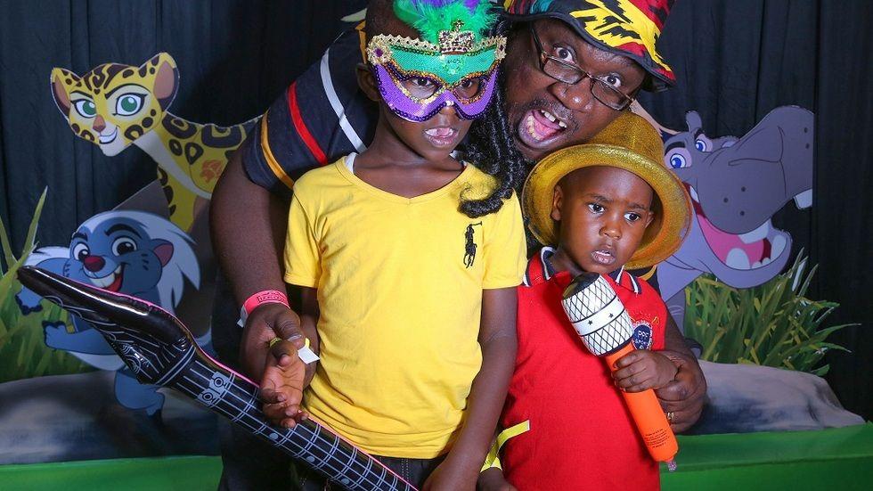 Papa Shirandula poses with kids at Lion Guard pre-screening in Nairobi