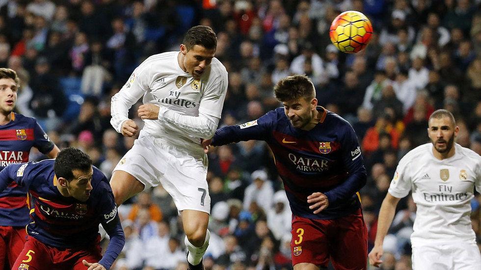 Cristiano Ronaldo competes for the ball.