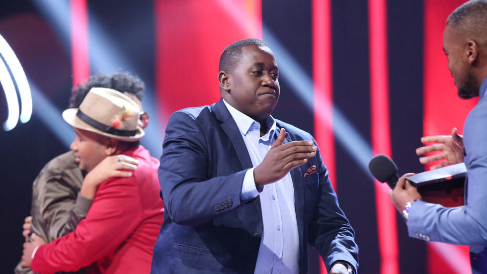 A contestant on The Voice SA shakes Lungile Radu's hand.