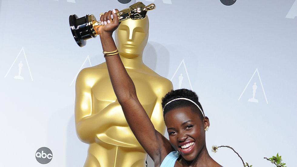 Lupita Nyongo'o celebrating after winning the Academy Award for 12 Years A Slave
