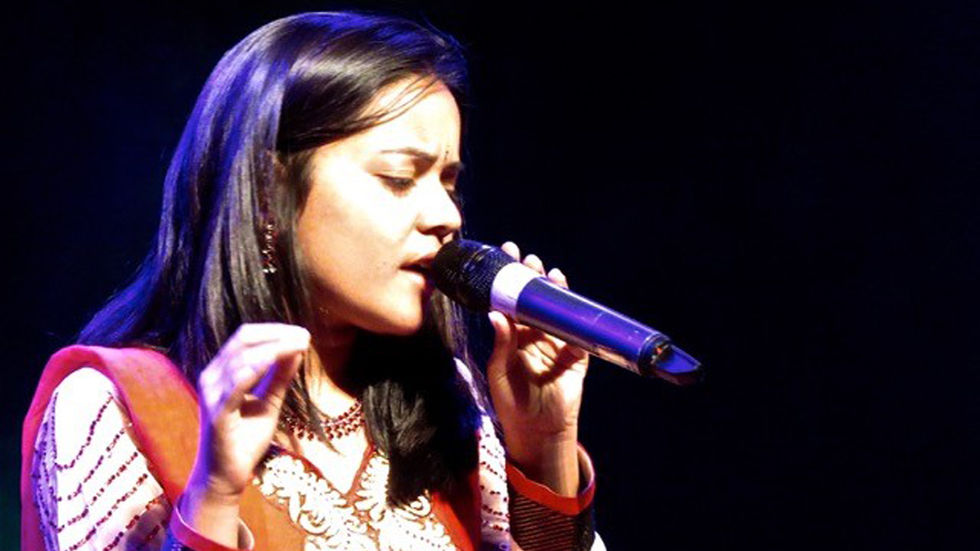 Maithili Shome performing on stage.