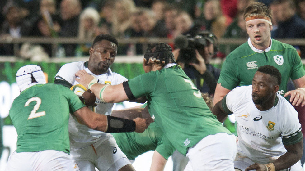Springboks winger, Lwazi Mvovo gets tackled.