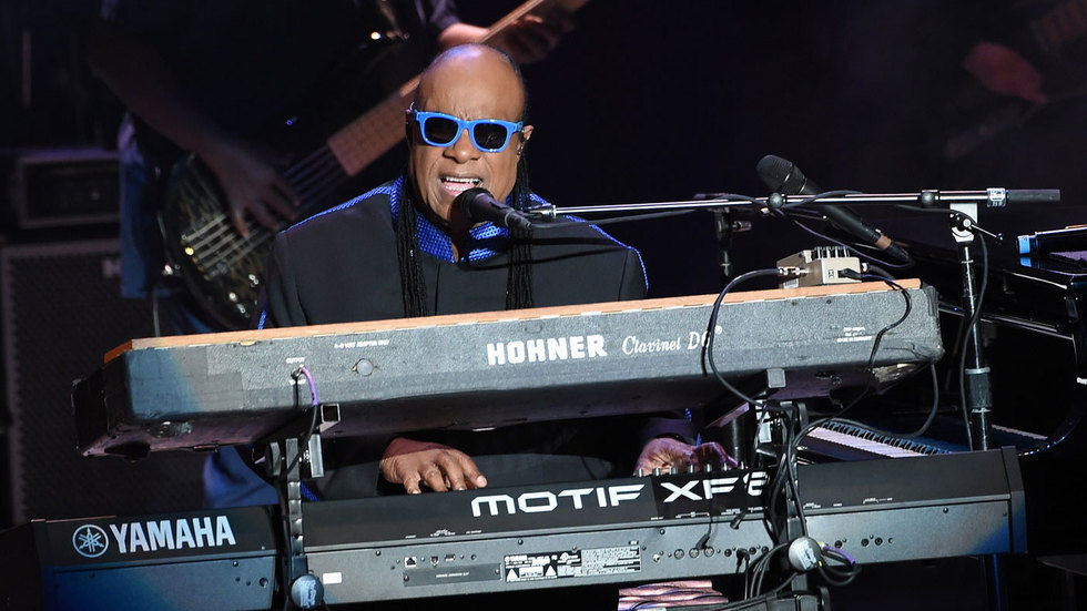 Stevie Wonder performing.