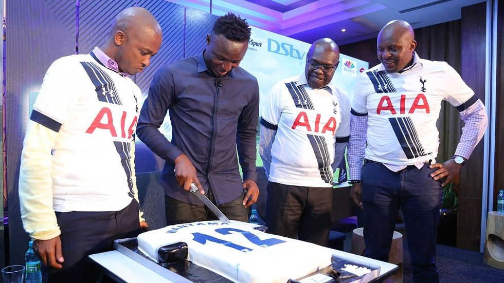 Tottenham Hotspur Victor Wanyama cuts his birthday cake alongside FKF President Nick Mwendwa and SuperSport EA GM Auka Gecheo