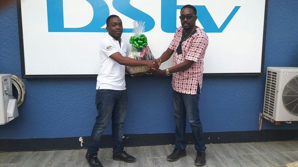 A DStv winner receives his prize