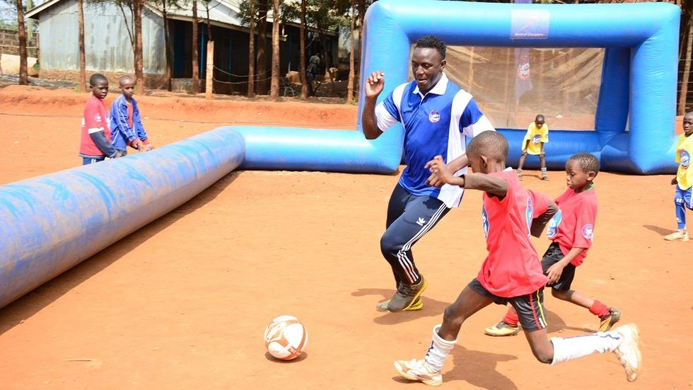 Victor Wanyama during Let's Play in Kibera