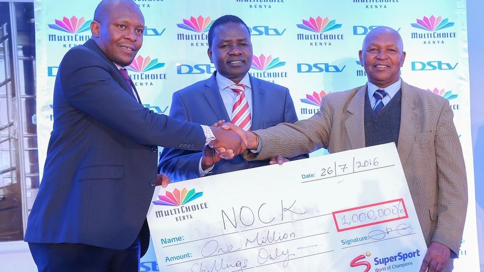 SuperSport EA GM Auka Gecheo handing over a one million cheque to Sports PS and Olympics official Kip Keino