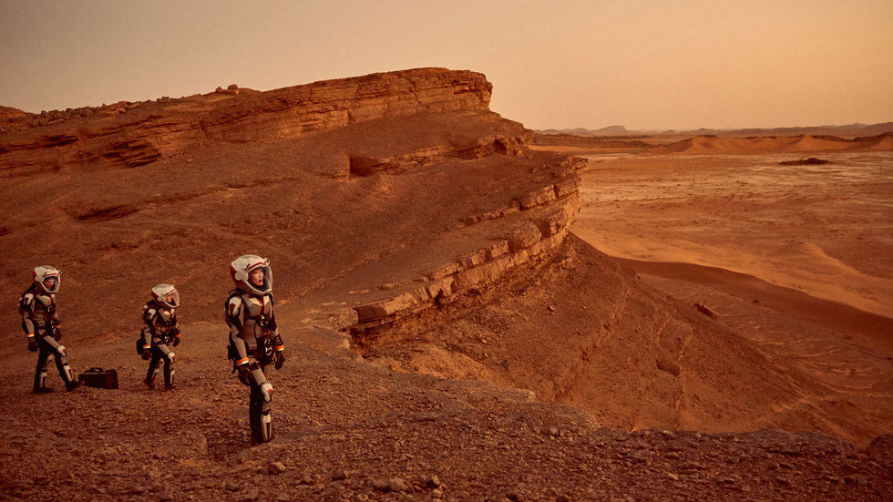 Astronauts walking on Mars.