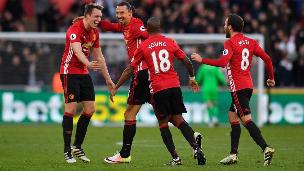 Zlatan Ibrahimovic celebrates with teammates.