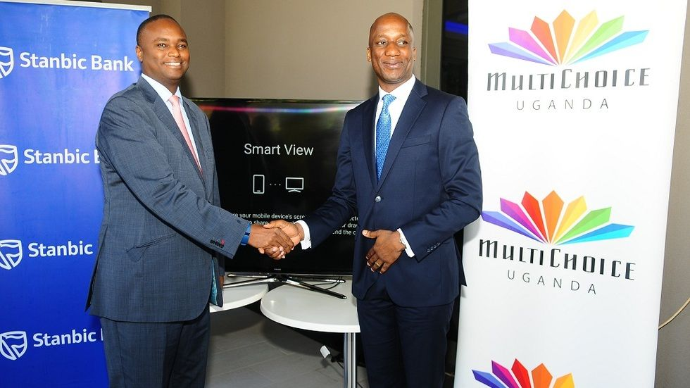 Patrick Mweheire of Stanbic Bank Uganda and Charles Hamya of MultiChoice Uganda