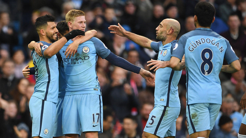 Sergio Aguero celebrates with teammates.