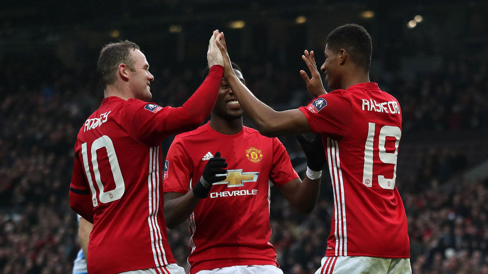 Timothy Fosu Mensah celebrates with teammates.