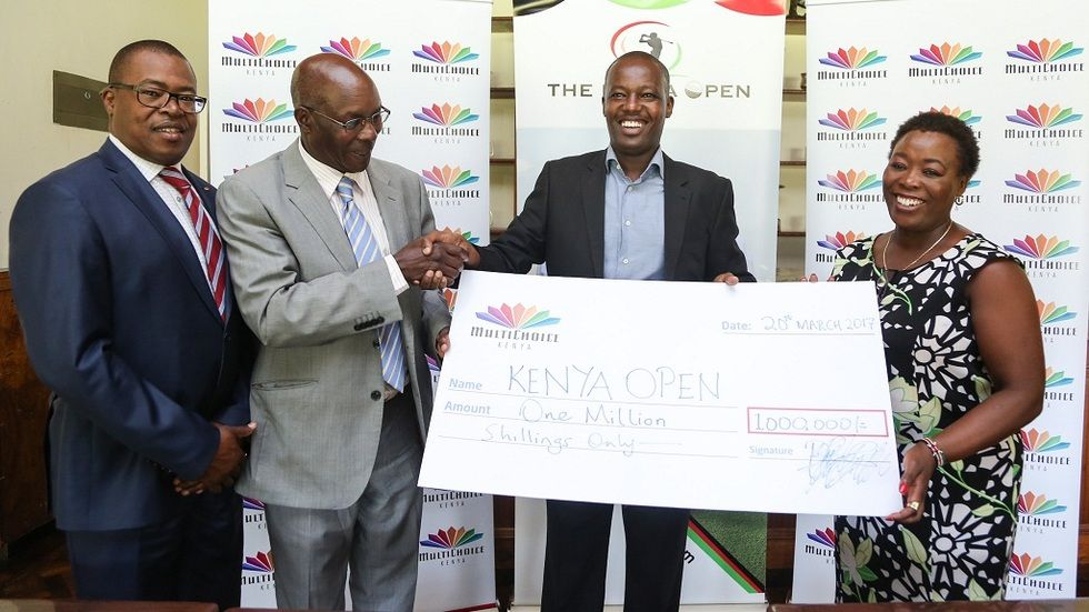 Multichoice Kenya, Corporate Communications Manager, Philip Wahome (second from right) hands over a Kshs. 1 million DStv sponsorship to the Chairman of the Kenya Open Golf Limited – Peter Kanyago (second from left). Looking on is Kenya Golf Union Cha