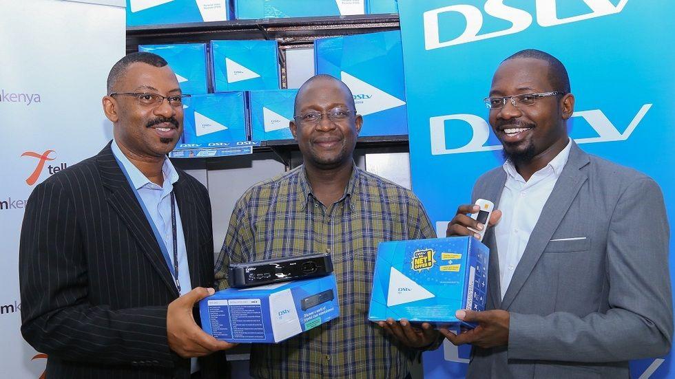 DStv Sales and Distribution Manager, Steve Kombo holds a DStv HD decoder alongside Nakumatt Junction Mall Branch Manager, Boaz Opondo (center) and Telkom Kenya's Chief Corporate Communications Officer, George Mlaghui (right) during the DStv - Telkom