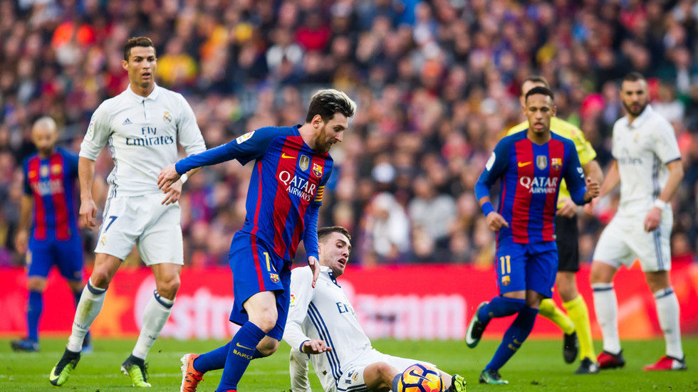 Lionel Messi battles for the ball.