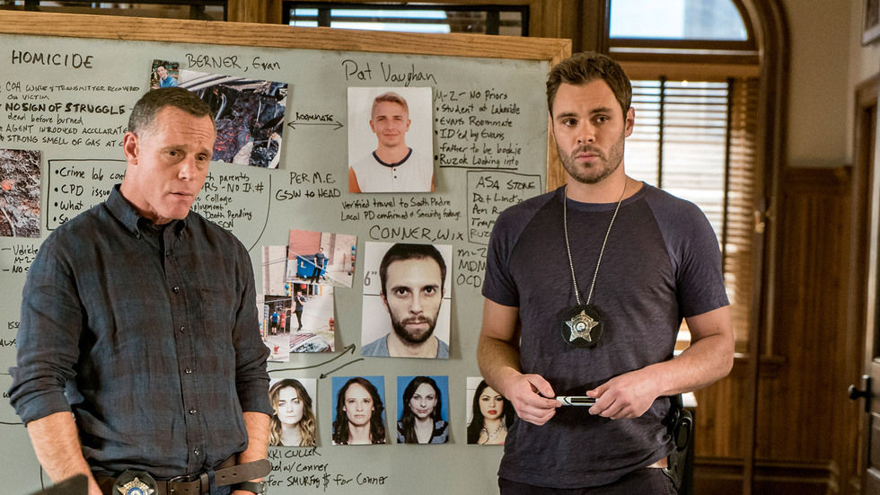 Chicago PD season 4 characters standing next to a crime board.