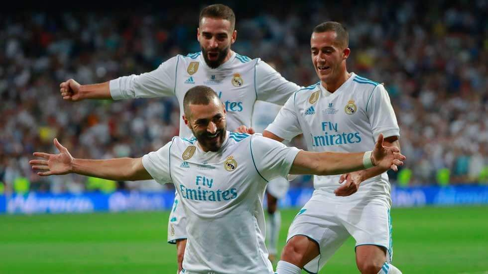Karima Benzema and teammates celebrate during a game.