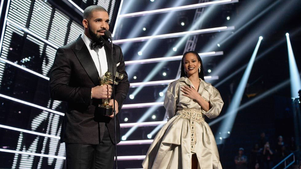 Rapper Drake (L) and singer Rihanna speak onstage during the 2016 MTV Music Video Awards at Madison Square Garden on August 28, 2016 in New York City. (Photo by Kevin Mazur/WireImage)