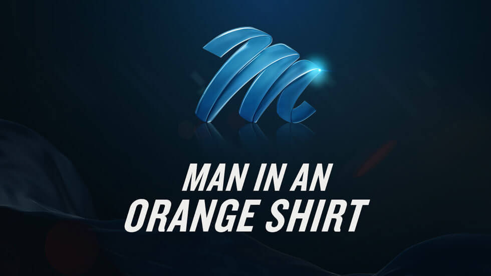 Man in an Orange Shirt M-Net logo.