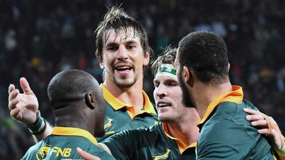 Eben Etzebeth celebrates with teammates.