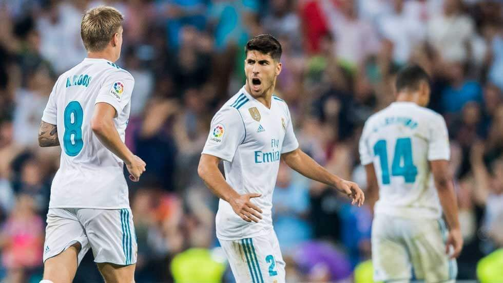 Marco Asensio Willemsen celebrates after scoring a goal.