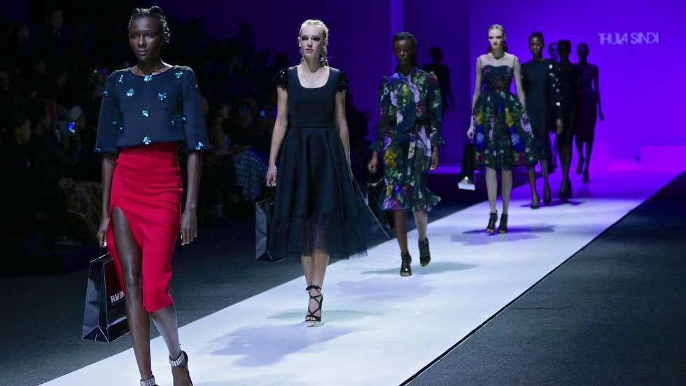 An image of models in Thula Sindi on the catwalk at MBFWJ