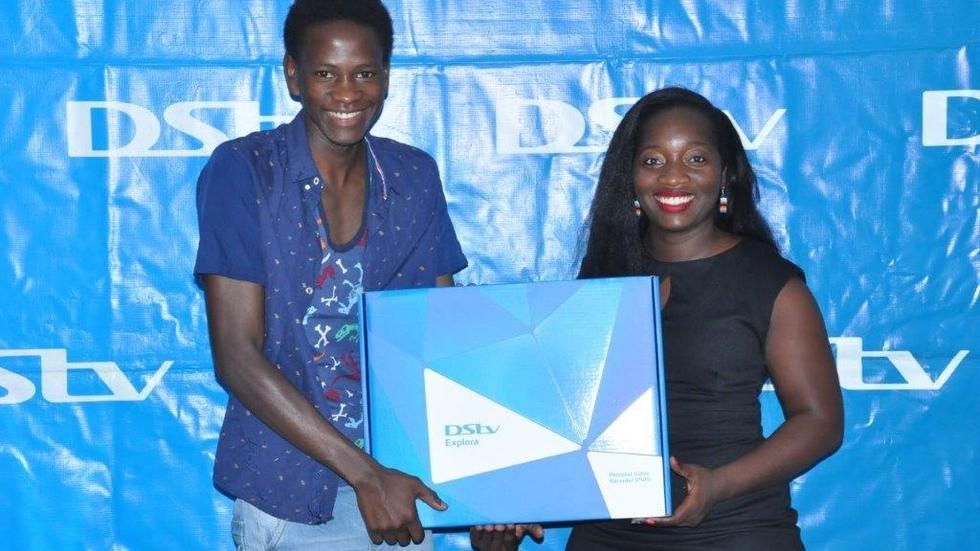 Uganda PR Manager Tina hands over Explora to lucky winner