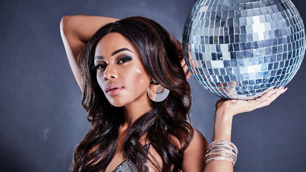 Bonang holds up a disco ball.