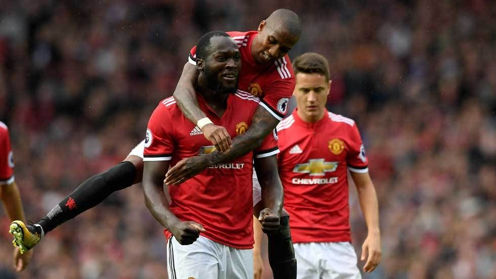 Romelu Lukaku celebrates a goal with Ashely Cole.