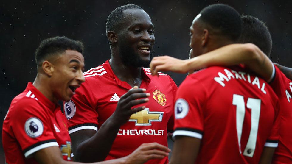 Romelu Lukaku celebrates with his fellow Manchester United teammates.