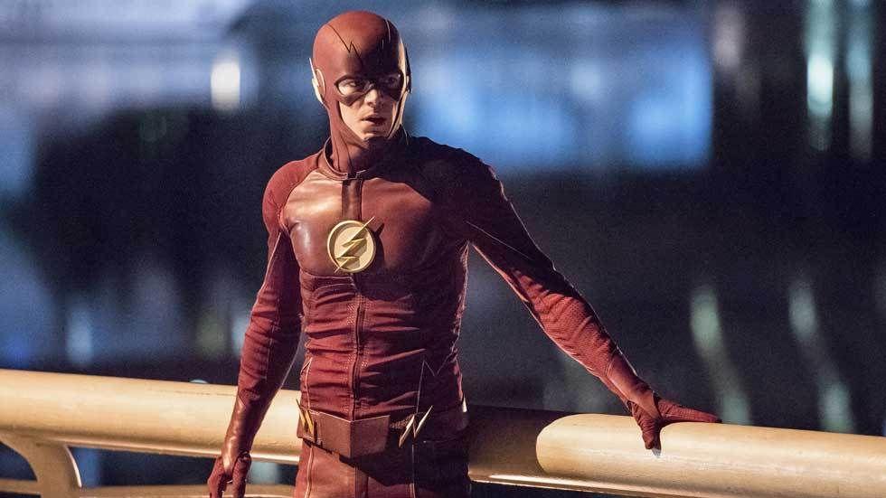 The Flash looks on.
