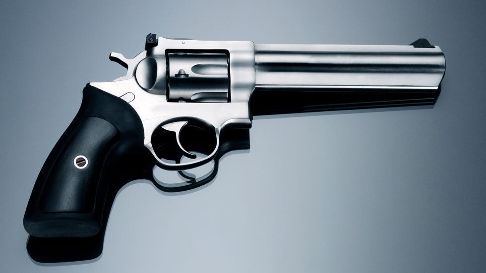A picture of a revolver on a grey background