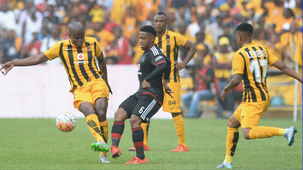 Kaizer Chiefs players mark an Orlando Pirates player for the ball.