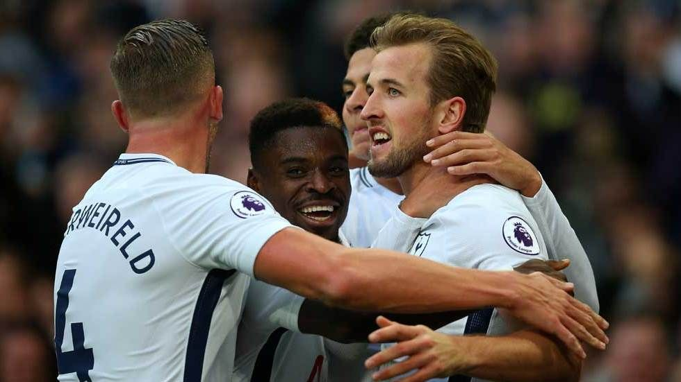 Harry Kane celebrates with teammates.