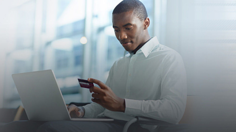 A man making a payment with his card.