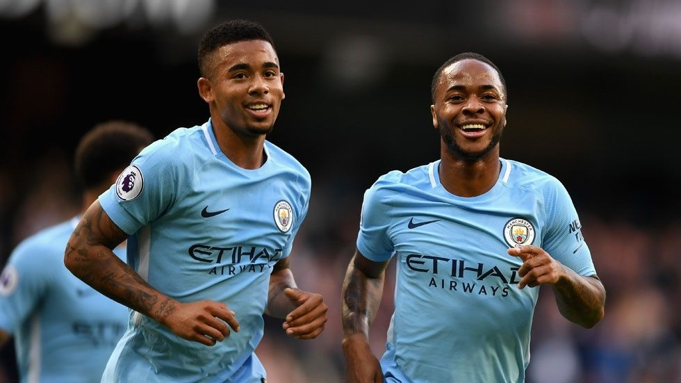Man City players smiling on field