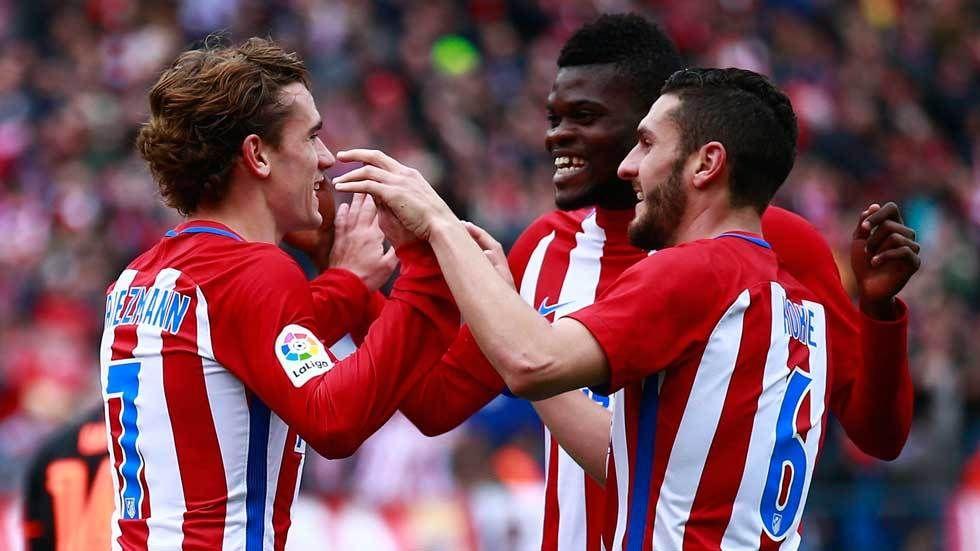Antoine Griezmann of Atletico de Madrid celebrates scoring their third goal with teammates Thomas Teye Partey and Koke.