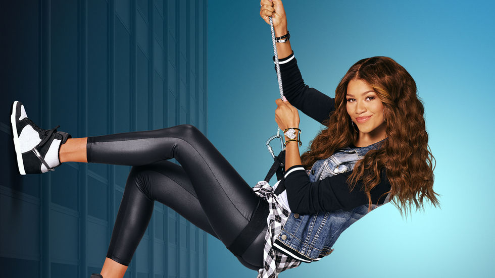 Zendaya as KC hangs from a rope.