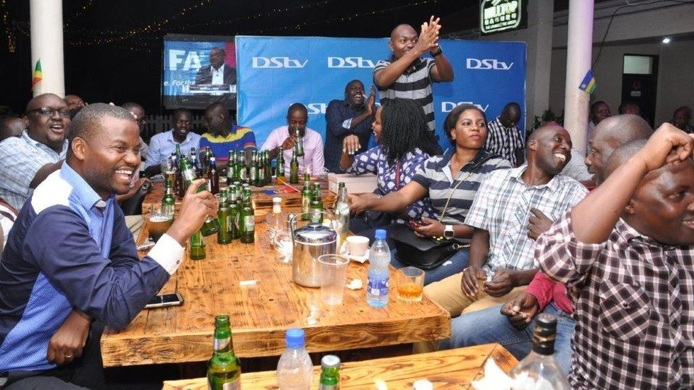 DStv customers excited as they watch the World Cup draws screening held at Hilltop Naguru recently