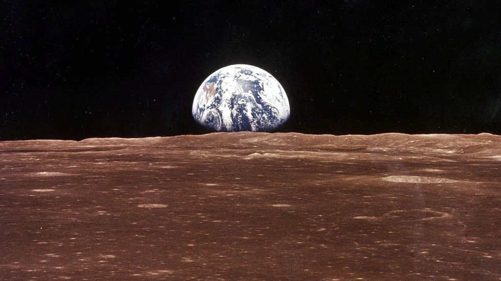 An image of the moon and earth from space.