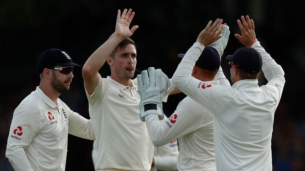 Chris Woakes on England celebrates with teammates in the second day of the third Ashes series Test against Australia.