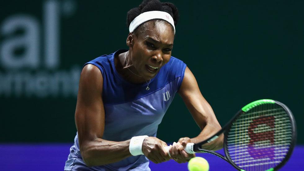 Venus Williams plays a backhand in the Singles Final against Caroline Wozniacki.