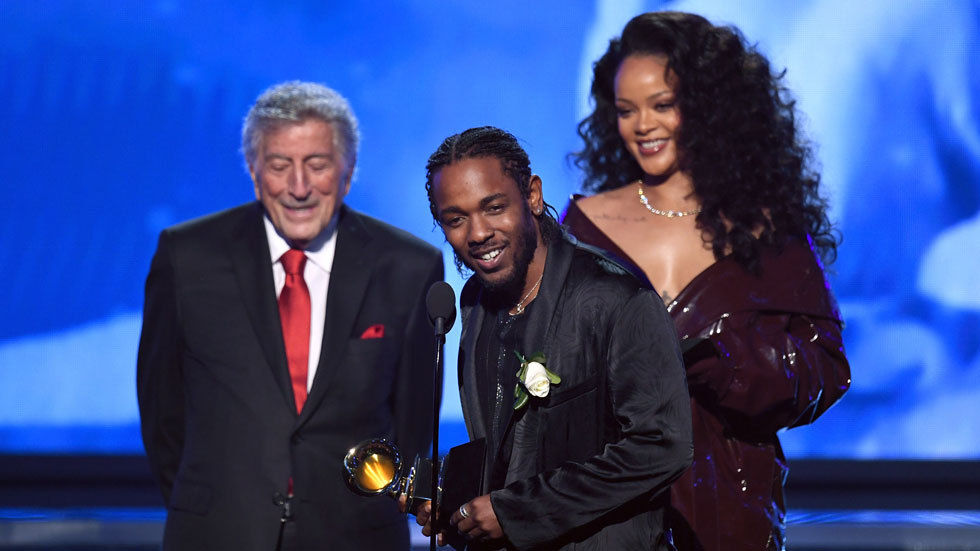 Recording artists Kendrick Lamar (C) and Rihanna (R) accept Best Rap/Sung Performance for 'Loyalty' from Tony Bennett (L) onstage during the 60th Annual GRAMMY Awards at Madison Square Garden on January 28, 2018 in New York City. (Photo by Kevin Wint