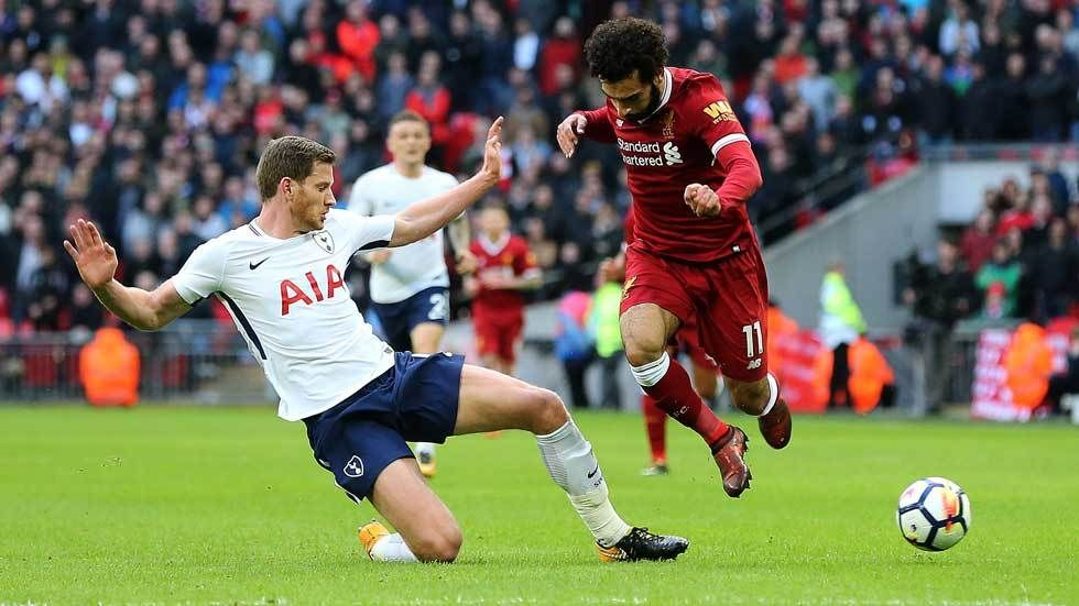 Jan Vertonghen challenges for the ball in the Premier League fixture against Liverpool.