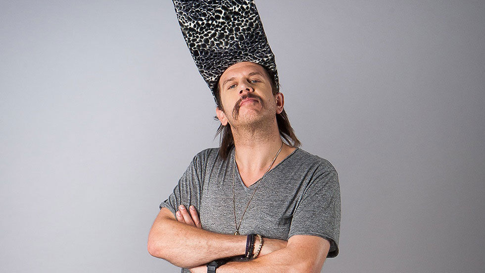 Jack Parow with arms crossed and strange hat
